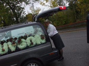 Kim is loading floral tributes.